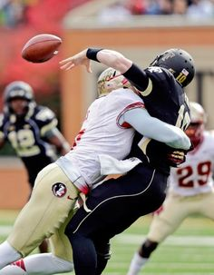 Florida State linebacker Christian Jones, left, forces a fumble as he hits Wake Forest quarterback Tanner Price. Football Hits, College Football, Football Reference, Wake Forest, Football Pictures, Lsu, American Football, Alabama, Basketball