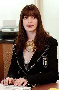 Andie Sachs's lovely gold necklaces completed her Chanel look.