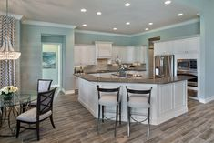 Models | Muirfield Iv | Indoor Swimming Pools, Swimming Pool Designs, Beach Cottage Kitchens, Mediterranean House Plans, Transitional Kitchen, Architectural Design House Plans, House Rooms, Great Rooms, New Homes