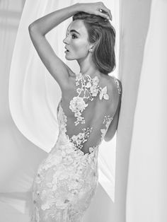 Get your first look at the 2018 Atelier Pronovias Collection. Stunning and dramatic as always, you will not want to miss this collection of handworked masterpieces.