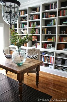 love the centerpiece, gray walls, and the dark blue behind the shelving