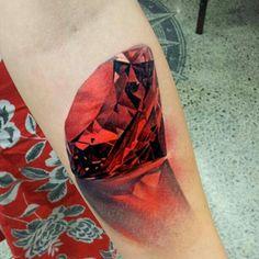 Red jewel tattoo by Matt Jordan at Matt Jordan's Ship Shape Tattoo Juwel Tattoo, Ruby Tattoo, Form Tattoo, Stone Tattoo, Symbol Tattoos, 3d Tattoos, Sexy Tattoos, Body Art Tattoos, Tattoo Forearm
