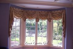 Swags and Jabots and bells with tassel trim. on bay window.