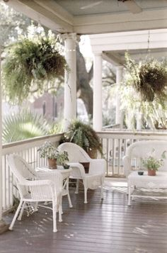 White porch, wicker & hanging ferns