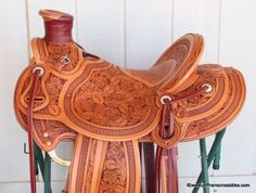 Half Seat Wade Saddles   addle with custom border stamp and roses