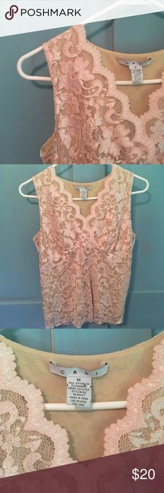 Gorgeous blush lace CAbi sleeveless top size M This is a STUNNING blush colored lace top with cream underlay. In excellent condition! Length of top from shoulder to bottom is approx. 21.5 inches. This is not a long top. Hits at top of waistband of pants. It is simply a gorgeous piece. Tops Tank Tops