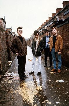 The Smiths during their 'Salford Lads Club' shoot, Manchester, England (1985) ― photo by Stephen Wright.