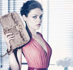 Pretty in pink! Dior's newest darling Mila Kunis in latest handbag campaign. Terrific!