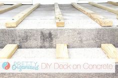 DIY: Building a Deck on Concrete  - will need if we ever extend the porch around the house to make it all uniform wood decking. Woot woot wraparound porch! #buildadeck