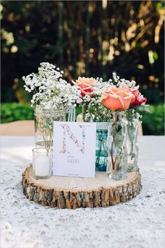 I'd love to decorate with blue mason jars, layers of tree stumps as platters, babies breath and yellow wildflowers