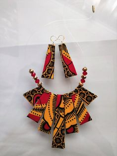 African handmade gifts Jewelry for women with clutch purse, valentine day gift for her, Waterfall Ankara Necklace African statement earrings - Small Things Great Love! Hand-made vibrant african fabric necklace with subtle gold beaded accents - Diy African Jewelry, African Accessories, African Earrings, African Crafts, Hair Accessories, Textile Jewelry, Fabric Jewelry, Beaded Jewelry, Wire Jewelry