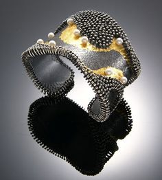 Wearable art jewelry by So Young Park Studios.