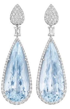 diamondsinthelibrary:  Margherita Burgener.  A Pair of Aquamarine and Diamond Ear Pendants.  Each suspending an aquamarine drop, weighing approximately 72.71 carats in total, within a pavé-set diamond surround, from a square-cut diamond link, to a pavé-set diamond surmount, mounted in 18K white gold, length 2 ½ inches. Signed 'Margherita Burgener', 'Italy', with a Margherita Burgener box. Philips de Pury.