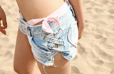 cut shorts down side, snip the belt holders off of jeans and stitch them on the sides of the shorts. so cute