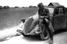 German soldier( probably the driver ) taking a pause for smoking. Russia 1941.