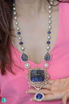 A dramatic pearl and blue lapis necklace.
