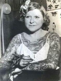 """Mildred Hull, """"Queen of the Bowery"""" Unlike many of the early female tattoo artists, Mildred learned not from a boyfriend or lover, but from first scratching tattoos out on herself. She struck-out on her own and built a business that stretched out over 25 years until her untimely death in 1947. Initially a burlesque dancer who was first tattooed by a boyfriend, Millie later apprenticed under Charlie Wagner, inventor of the electric needle. Hull, like many tattoo artists of the time…"""