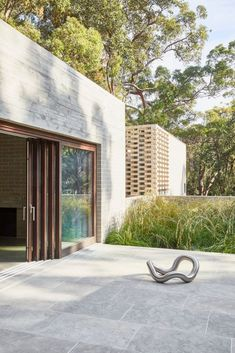 """The primacy of this living space is reflected in the fact that it is slightly larger than the main internal living area and contains a hearth – the traditional focal point and symbol of the interior. This elevated outdoor space itself feels like a """"sunny clearing"""" in the forest, one of several moments of compression and release that parallel the sense of relief found in stumbling upon a clearing when walking through bush. #outdoorarea #outdoorspace #australianhomes #homedesign #homeinspiration Pearl Beach, The Locals, Interior Architecture, Beach House, All Design, House Design, Australian Homes, Cool Designs, In This Moment"""