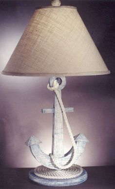 On Sale for 0 for limited time. Anchors Away Lamp is a designer lamp made out of wood. The base of this nautical table top lamp features a round wooden base with rope neatly circling the top of the base. Anchor Bedroom, Nautical Bedroom, Coastal Bedrooms, Coastal Living Rooms, Nautical Home, Nautical Interior, Beach Cottage Style, Coastal Cottage, Coastal Homes