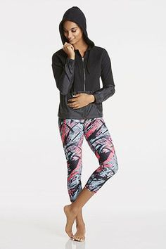 Take on the city streets in a mixed media zip-up with a cinchable hem. Slip it off at the gym to work out in our medium-support bra and high-performance blue and pink goddess-print capris.   Iris Outfit - Fabletics