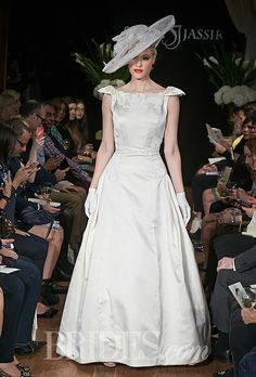 "Brides.com: Sarah Jassir - Fall 2014. Sarah Jassir on her Fall 2014 collection:  ""This season designer Sarah Jassir takes the inspiration for her bridal collection from the rich legacy of the 1950's haute couture. The 1950's represented the height of haute couture and marked a new era of feminine glamor and extravagance. In keeping with this tradition, the designer adheres to the simple edict that everything must follow the body of woman. The end result is a collection of unparalleled…"