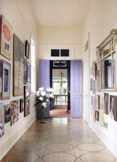 hallway art gallery ... floors + purple doors