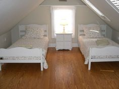 If I didn't know better I'd say this is the room my sister and I once shared.  Love attic rooms! (with windows that is)