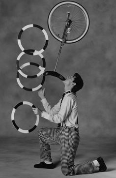 Juggling 4 hoops while balancing a unicycle on my chin.