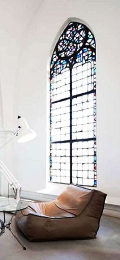 do a faux stain glass wall with lighting/scene.