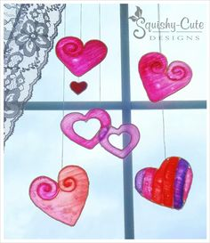 Valentine crafts for kids - heart suncatchers - easy stained glass alternative - free Valentine's Day craft ideas - homemade Valentine decorations