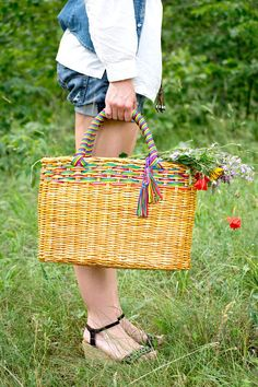 Very comfortable and stylish to use a market bag. It is also well suited as a Picnic basket, Shopping bag or Beach bag. Wicker bag is made from recycled materials (newspapers), yellow color, decorated with multicolor ropes, handles are made of rope. In spite of the material from