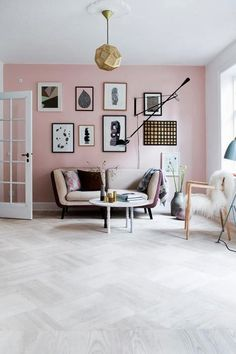 My Trend Forecast for 2014 - Part of the Pastel colour trend. But what I like most about this room is the fact that it embraces of trendy decor elements - warm metal gold pendant light; wall gallery; mid century modern furniture.