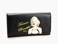 Marilyn Monroe Wallet Forever Beautiful. Marilyn Monroe Long Wallet. Snap Closure. Credit card slots and ID holder. Bills Compartment. Coins pocket with zip.