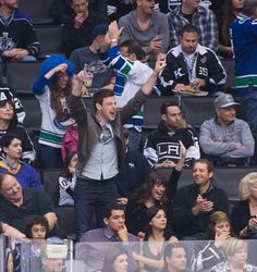Cory Monteith and Lea Michele celebrated while watching a hockey game between his beloved Vancouver Canucks and the LA Kings in March 2013.