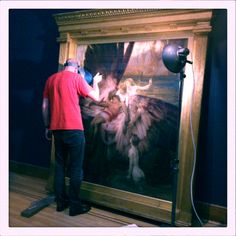 Draper's Lament for Icarus being condition-checked ready for Love and Death at Birmingham Museum and Art Gallery.