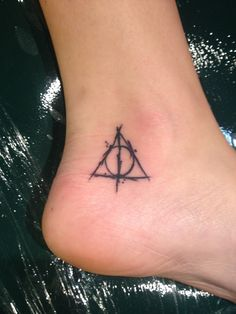 nicely done Deathly Hallows tat