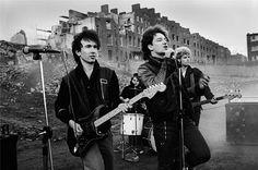 "U2 performing ""Gloria"" at the demolition of 120 georgian houses in Dublin City. 1981."