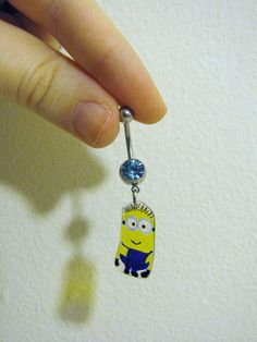 Eco Friendly dangle minion belly ring by FrozenFairytale on Etsy Despicable me not gonna lie I might were this little guy tehe Bellybutton Piercings, Cute Piercings, Piercing Ring, Body Piercings, Piercing Tattoo, Piercing Ideas, Tongue Piercings, Cute Belly Rings, Belly Button Rings