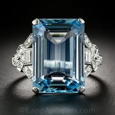 Platinum Art Deco Aquamarine and Diamond Ring. A stunning example of Art Deco opulence is showcased in this extraordinary yet understated Aquamarine and Diamond ring. The aquamarine, weighing approximately 11 carats, is richly saturated, evocative of the color of limpid Caribbean lagoons.