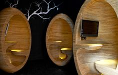 Designed by Emma Selzer , Plus Architecture created 'laptop pods' (egg-like pods of stacked laser-cut plywood) for Society, a 242-apartment development in Melbourne's South Yarra.