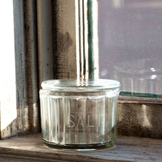 """Sturdy and embossed with """"salt,"""" this little jar will keep your salt moisture free and ready to add spice to your life. $14. See more at: http://shop.pallensmith.com/kitchen/glass-salt-canister/#sthash.hMxRkJMs.dpuf"""