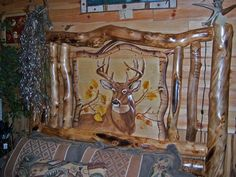 Detail of Deer Carving on Aspen Log Bed Headboard - Item # BR04001 - Available in Queen or King