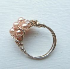 Etsy の Soft pink Swarovski pearl wire wrapped ring by MGMart