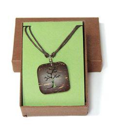 Hand-carved tree pendant coconut shell necklace.  http://macondoartisans.com/shop/unisex/tallista-necklace/