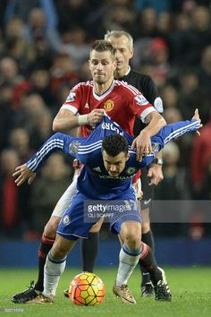 Manchester United's French midfielder Morgan Schneiderlin (back) challenges Chelsea's Spanish midfielder Pedro (front) during the English Premier League football match between Manchester United and Chelsea at Old Trafford in Manchester, north west England, on December 28, 2015. AFP PHOTO / OLI SCARFF No use with unauthorized audio, video, data, fixture lists, club/league logos or 'live' services. Online in-match use limited to 75 images, no video emulation. No use in betting, games or…