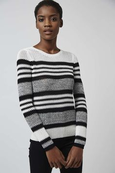 Slinky shapes and bold stripe details update knitwear for now. Crafted in a soft knitted mesh, this long sleeved top features a striking all-over striped detail with a crew neckline and contrasting cuffs. Throw on with your favourite denim for an effortlessly casual-cool look. #Topshop