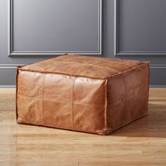 On sale. Introduce hide to your habitat via authentic aniline-dyed buffalo leather, revealing natural grain and texture that wears and softens over time. Hand-stitched quadrants shape up sides with flange edging. Modern Throw Pillows, Throw Blankets, Faux Fur Bean Bag, Moroccan Leather Pouf, Large Leather Ottoman, Leather Ottoman Coffee Table, Moroccan Pouf, Modern Ottoman, Chairs