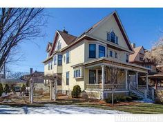 Stunning Victorian home. Exquisite woodwork. Magnificent stained glass. Beautiful updated kitchen. Over sized lot. Gracious front porch. New siding new combination storms. New insulation, newer roof. Ample parking. Walk to Lake of the Isles.