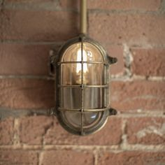 Bulkhead Outdoor Light in Antiqued Brass Retro Products retro style products Outdoor Wall Lighting, Outdoor Walls, Bathroom Lighting, Outdoor Pergola, Industrial Coffee Shop, Garden Wall Lights, How To Clean Brass, Modern Properties, Retro Style