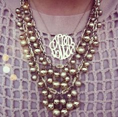 love monogram jewelry with additional necklaces (look like pearls)